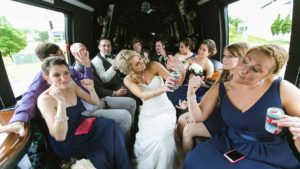 wedding party celebrating in limo