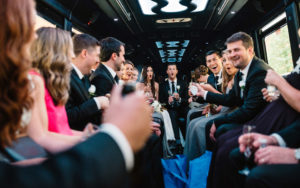 wedding party celebrating wedding in limo